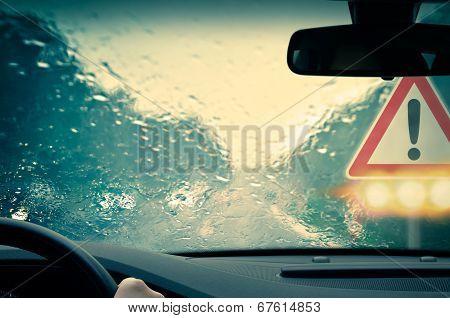 Bad weather driving on a highway - Caution