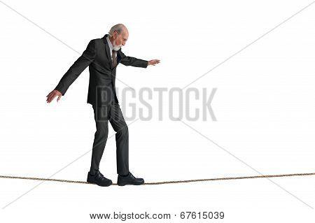 Senior Man Walking A Tightrope