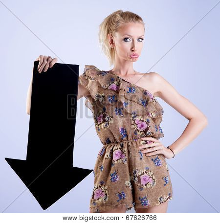 Attractive Blonde Woman Posing With Arrow