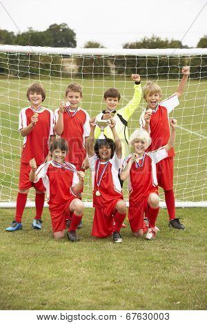 Winning junior football team portrait poster