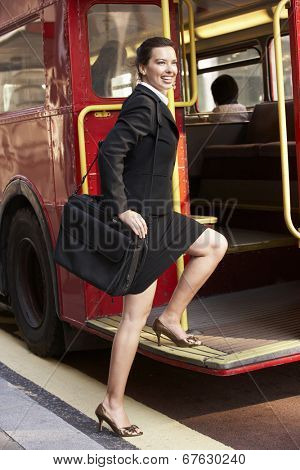 Businesswoman boarding Routemaster bus