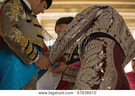 Bullfighter Getting Dressed