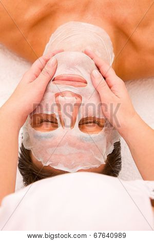Therapist Applying Face Mask Man's Face