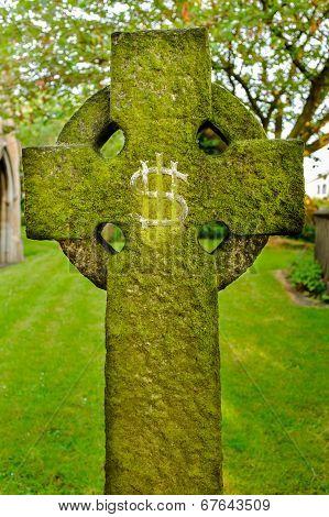 A gravestone bearing an IHS Christogram monogram
