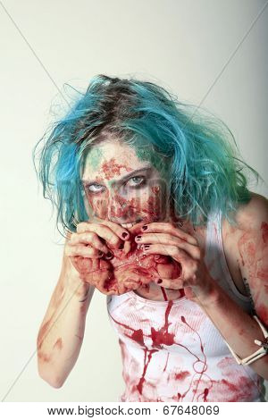 A genuine Female Zombie enjoys eating a Fresh Brain from her latest Victim. Zombies are currently the most popular monster in the entertainment field, even more than Vampires, Mummies, Aliens etc.