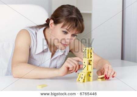 Young Woman Plays With Dominoes
