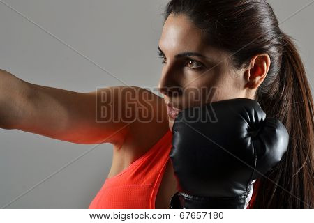 beautiful woman with the black boxing gloves