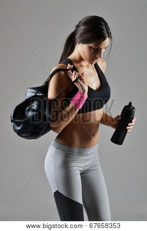 beautiful fitness woman with a gym bag