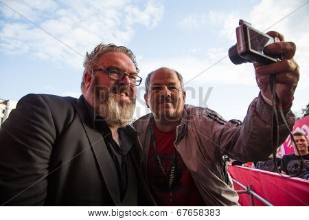 MOSCOW - JUNE, 19: Actor Kristian Nairn (Hodor, Game of Trones) with fan, 36th Moscow International Film Festival. Opening Ceremony at Pushkinsky Cinema . June 19, 2014 in Moscow, Russia