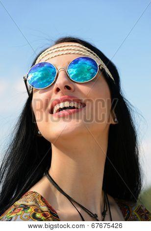 hippie girl in mirrored sunglasses