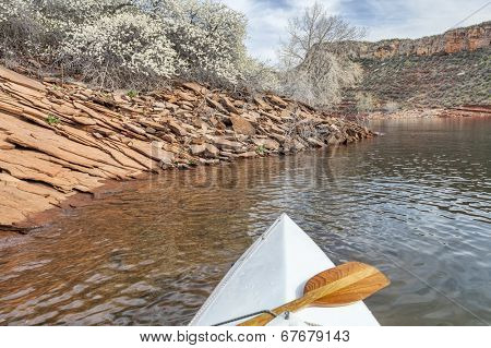 springtime canoe paddling - canoe bow with a paddle on Horsetooth Reservoir near Fort Collins, Colorado in spring scenery