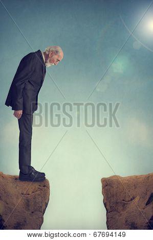Senior Man Looking Down A Crevasse