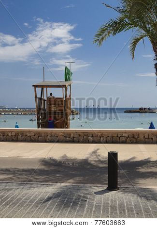 Green Flag On Lifeguard Tower In Cala Estancia