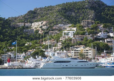 Large Yacht And Homes Perching On The Hills Above Port Andratx Marina.