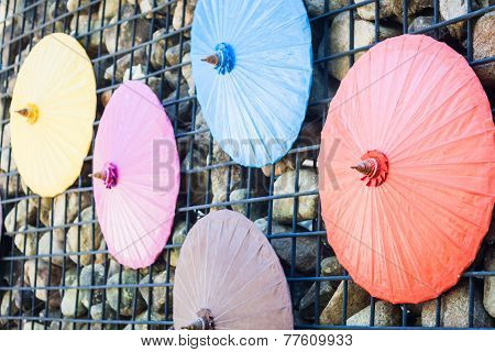 Brick Wall Decorated With Umbrellas
