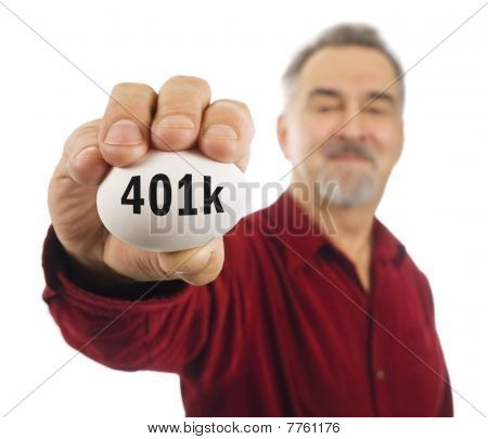 Mature Man Holds A White Nest Egg With 401K On It.