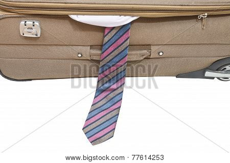 Male Tie From Ajar Suitcase Isolated On White