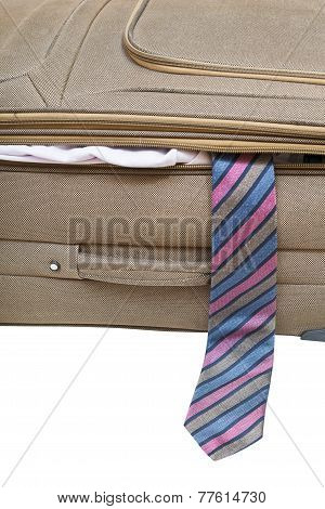 Tie Fell Out Of The Ajar Suitcase Close Up