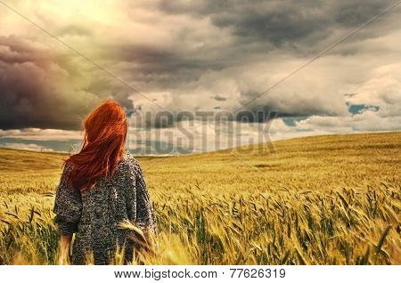 Fashion Young Red Hair Woman Standing Back Outdoor On Breathtaking View Of Dramatic Storm Sky