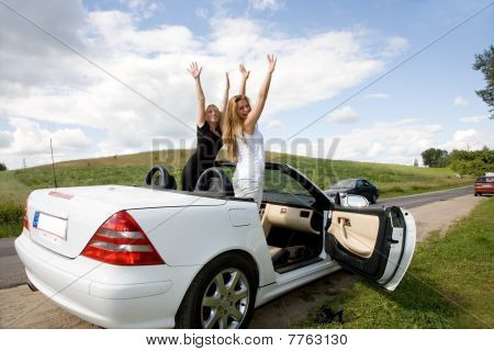 Portrait Of The Beautiful Young Girls With Cabriolet