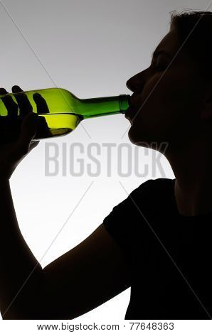 Alcoholic Woman Drinking From A Bottle