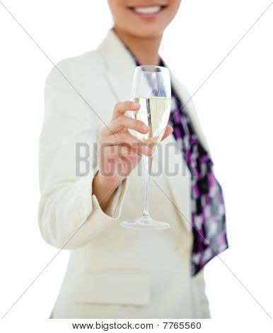 Close-up Of A Businesswoman Holding A Glass Of Champagne