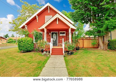 Small Coutnryside House Exterior In Bright Red Color With White Trim