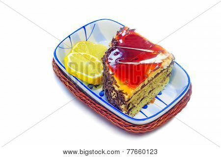 Cake And Slices Of Lemon On A White Background.