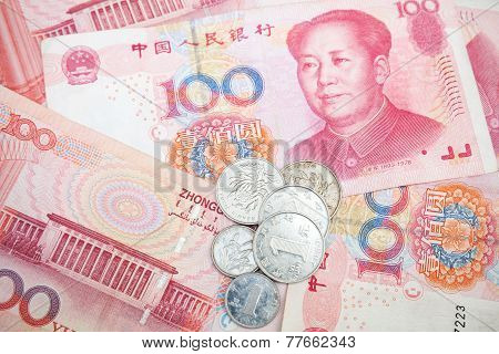Modern Chinese yuan renminbi banknotes and coins close up photo background poster