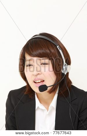 businesswomanof call center perplexed to a complaint telephone poster