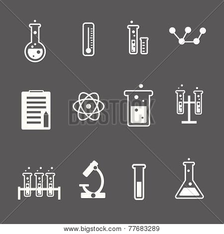 Set of white science and research icons on a grey background