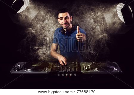 Deejay Mixing At Party