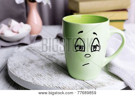 Emotional cup on wooden table