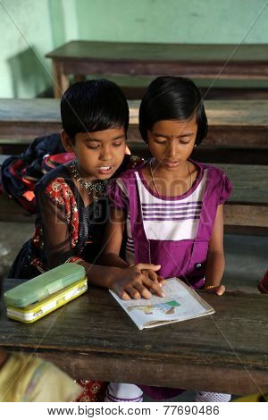 KUMROKHALI, INDIA - FEBRUARY 13, 2014: Kids learn at school. School name is the name of a famous Croatian missionary, Father Ante Gabric