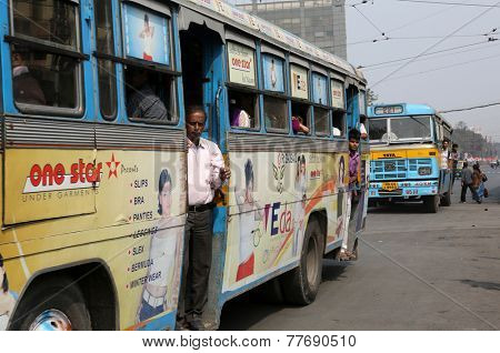 KOLKATA, INDIA - FEBRUARY 08: People on the move come in the colorful bus on February 08, 2013 in Kolkata, India. Kolkata and its suburbs, is home to approximately 14.1 million people.