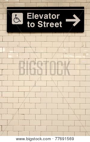 New York City Station Subway Directional Sign On Tile Wall.