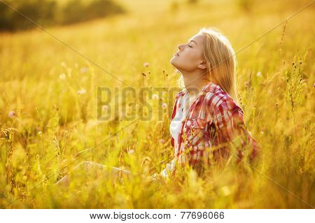 Girl With Closed Eyes In Wildflowers