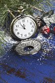 Happy New Year pocket fob watch with five to midnight time and decorations on dark blue rustic distressed vintage wood. poster