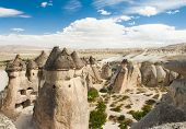 Fairy tale chimney rocks in Pasabg (Monk) Valley in Cappadocia, Turkey poster