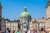 COPENHAGEN DENMARK - JULY 25: Frederik's Church popularly known as The Marble Church and castle Amalienborg with statue of Frederick V in Copenhagen Denmark on July 25 2014 poster