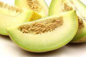 fresh galia melon pieces on a white background poster