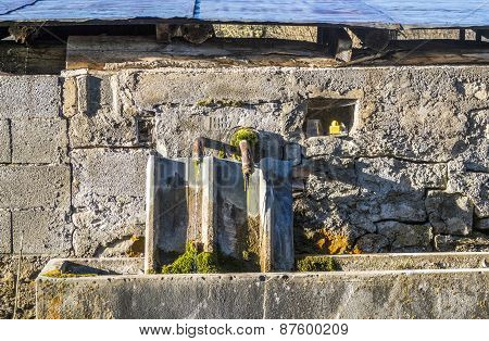 Old Water Fountain At A Farm House At Seigne Des Alps