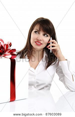 beautiful girl receives a surprise gift box with red bow and cal