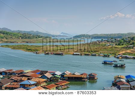 The raft houses along the river in Thailand