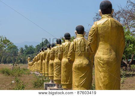Row of Buddhist monk statutes