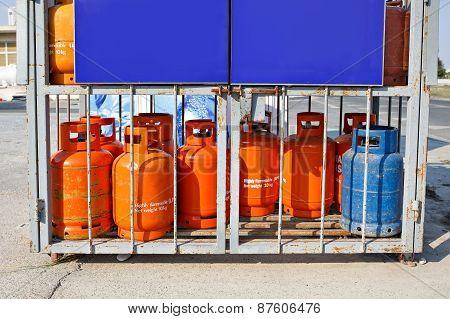 Old used gas bottles cylinders storage.