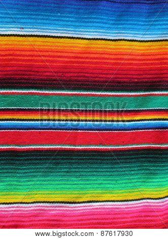 Mexican fiesta cinco de mayo stripe poncho serape background copy space