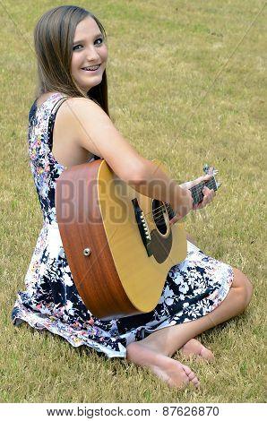 Beautiful Teen Girl With Guitar
