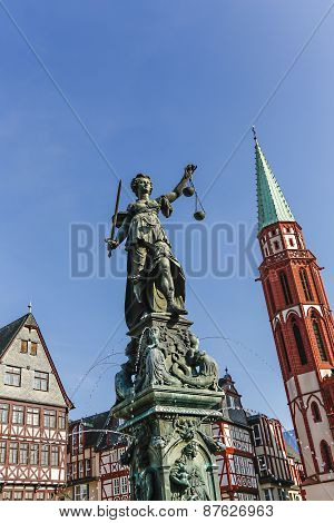 tatue of Lady Justice (Justitia) in Frankfurt Germany poster