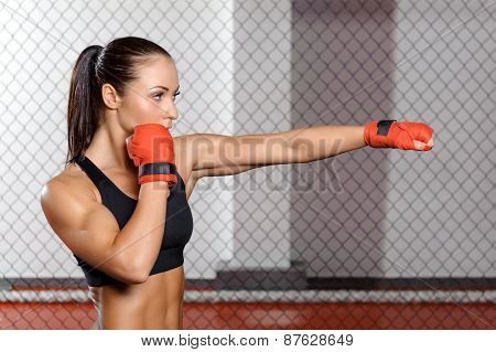 Female boxer fighting in a ring
